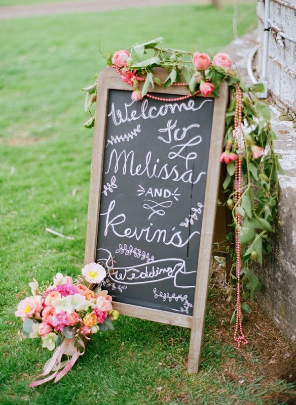 chalkboard wedding sign with flowers, photo by Lauren Fair Photography http://ruffledblog.com/stonebrook-farms-bohemian-wedding #weddingsigns #signage