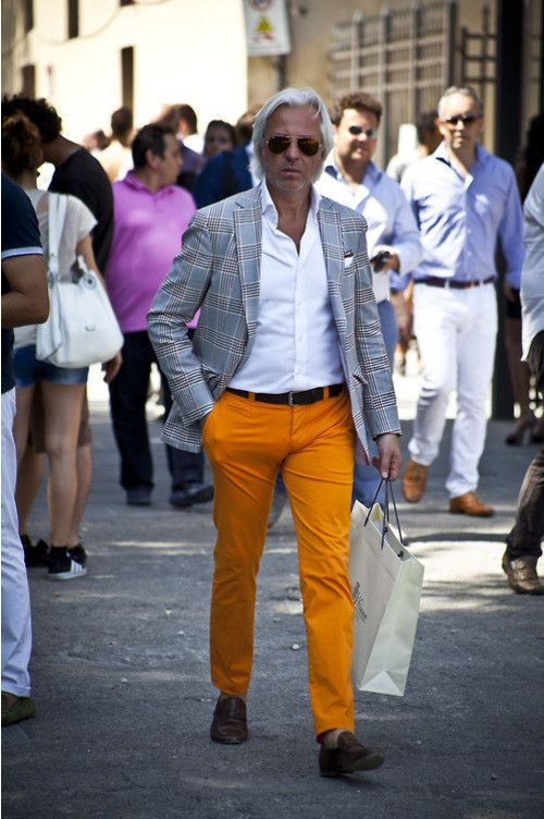 Men's Orange Chinos, Brown Leather Loafers, Brown Leather Belt, White Pocket Square, White Dress Shirt, and Grey Plaid Blazer