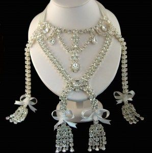 The Marie Antoinette Necklace ~ The loudest scandal of the 18th century engulfed the jewel which did not belong to the crown of France. In 1785 the Comtessa de la Motte was supposed to take it to Marie Antionette but she stole it instead. The necklace is now owned by a private collector. This replica is made as near as possible to the original. It is finished in silver plating