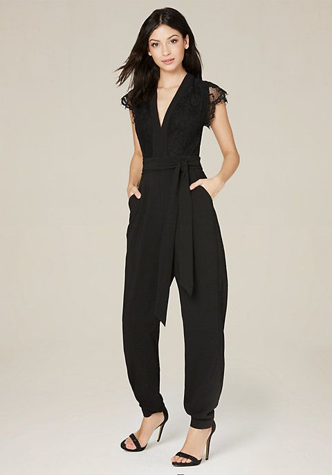 Cocktail-party jumpsuit with a delicate lace bodice and scallop-edged cap sleeves. Detachable tie belt. Front slash pockets. Back hook-and-eye and exposed zip closure. Partially lined.