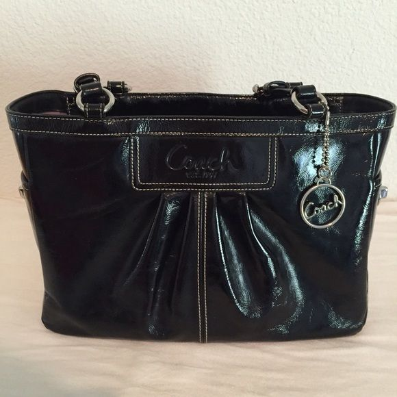 """⚡️FLASH SALE⚡️Authentic Black Coach Purse Black patent leather authentic Coach purse. Lavender Interior. Only used a few times for special occasions (because I was afraid to hurt it).Great condition. One tiny crack in the leather on strap, see photo. Didn't even know it was there until I searched the whole thing over. Dimensions: 12""""x8""""x4"""" I've dropped the price 60% since I first posted, just really want to sell this before it sits in my closet any longer!! Coach Bags Shoulder Bags"""