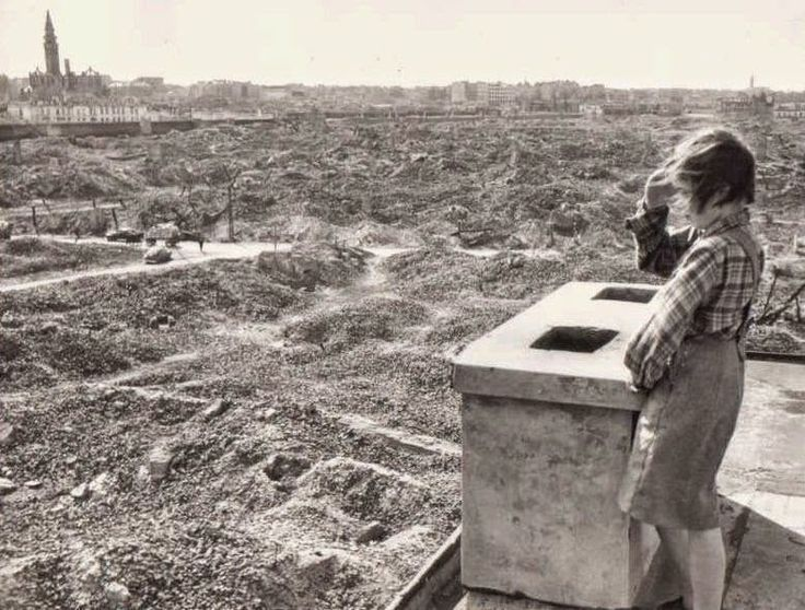 Girl looks at the ruins of the Warsaw ghetto, Poland, 1945