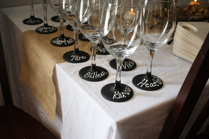 Dollar Tree $1 wine glasses painted with chalkboard paint. Perfect for this wine tasting bridal shower