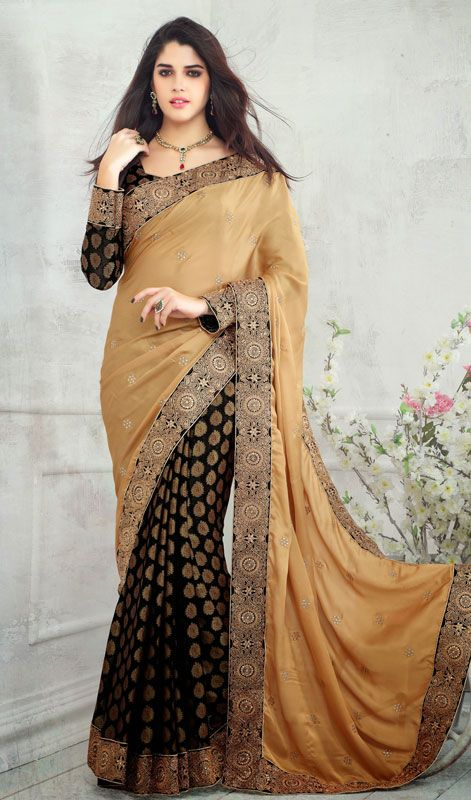 Beige and Black Satin Velvet Viscose Half N Half Saree Flaunt simplistic beauty draped in this beige and black satin velvet viscose half n half saree. The desirable lace, resham and stones work a significant characteristic of this attire. Comes with a matching stitched round neck blouse with 6 inches sleeves. #BuyDesignerSareesOnline #LatestWeddingSaris