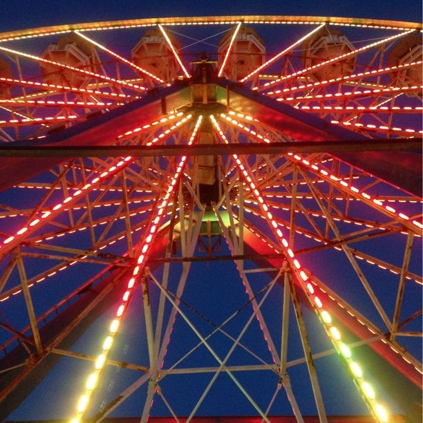 Daytona Ferris Wheel, Daytona Beach, Florida — by Cassandra  Collings. I just love this perspective of the Ferris wheel,, I rode it too!! What fun