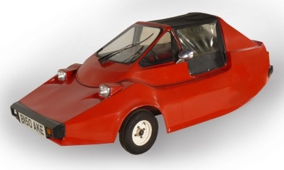 1985 Roller Motor Cursor -Factory built in Britain, the Cursor was designed to allow sixteen year olds to drive a car type vehicle on the UK roads, with only a moped license. The car was made between 1985-87 and over 100 were built.   The body was constructed out of fiberglass, and the chassis was tubular steel.   The car has 3 wheels.   One at the back and two at the front.   The vehicle is propelled via the rear wheel and the handbrake operates only on this wheel.