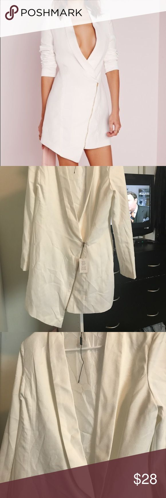 Misguided White Blazer Dress Side zip detail on white blazer dress. Never worn but has been in closet so it may need to be dry cleaned before wear. Sz U.K. 14. US 12 I believe Missguided Dresses Asymmetrical