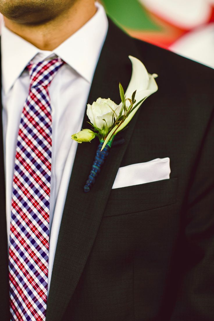 A white calla lilly and lisianthus make a great boutonniere for Kyle. Diamond Street Photography.