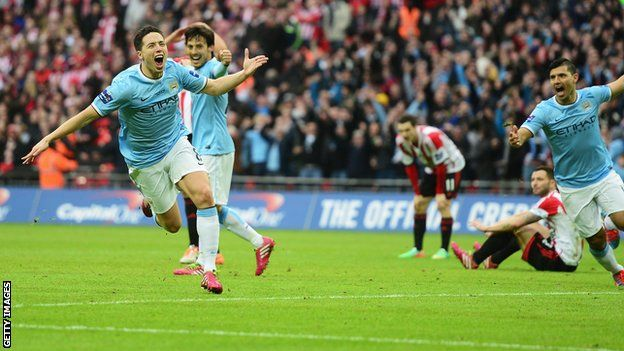 Manchester City boss Manuel Pellegrini won his first trophy in England as his side saw off spirited Sunderland in the Capital One Cup final at Wembley.