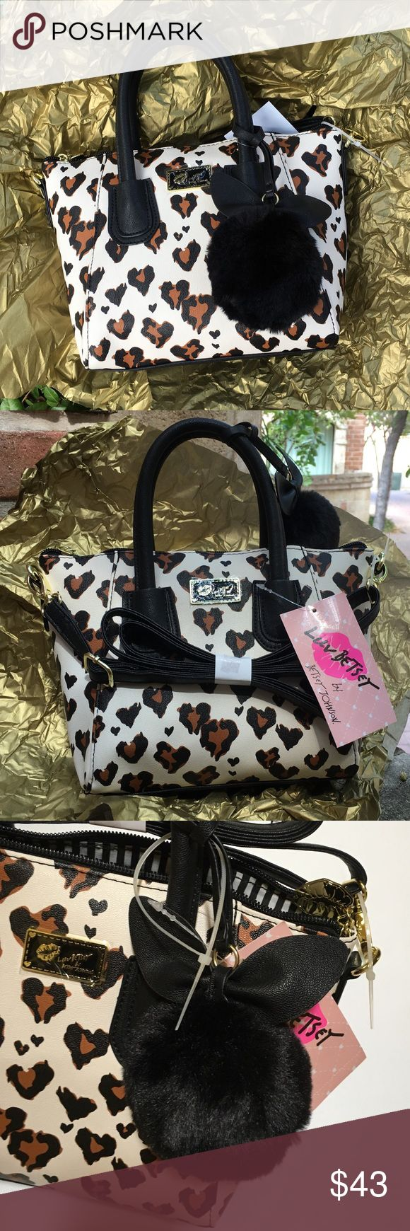 "Betsey Johnson Leopard Stripe Satchel Dome Purse Betsey Johnson Leopard LBGIYAA satchel dome purse. NWT. Attached with a cute fluffy cat face shape keychain. It can be a cross shoulder bag or a small handbag. Zipper closure with an inner zipper bag. Measurement: 7"" (H); 10"" (top length); 7 1/2"" (bottom length); 4 1/2"" (bottom width). Betsey Johnson Bags"