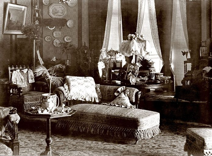 Interior view of Eldon House, 1895.  Note the abundance of bric-a-brac and elaborate Victorian furnishings