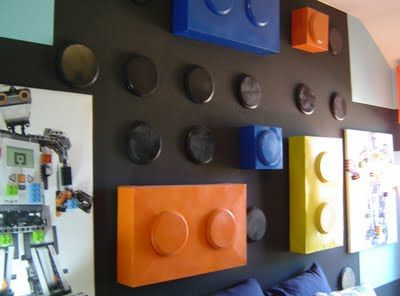 These are large gift boxes and large wooden disks spray painted in bright colors to look like Legos. - This would look so cool in my boys' room!