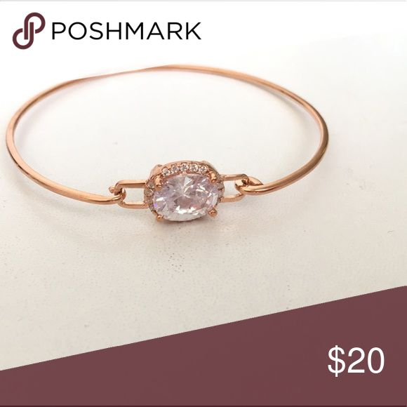 Oval CZ Rose Gold Bangle -Made of . 925 sterling silver with rose gold plated finish - Center oval shape CZ stone appox 8mm x10mm surrounded by  1.25 mm CZ stones Condition- new/never used just WOT tag Jewelry Bracelets