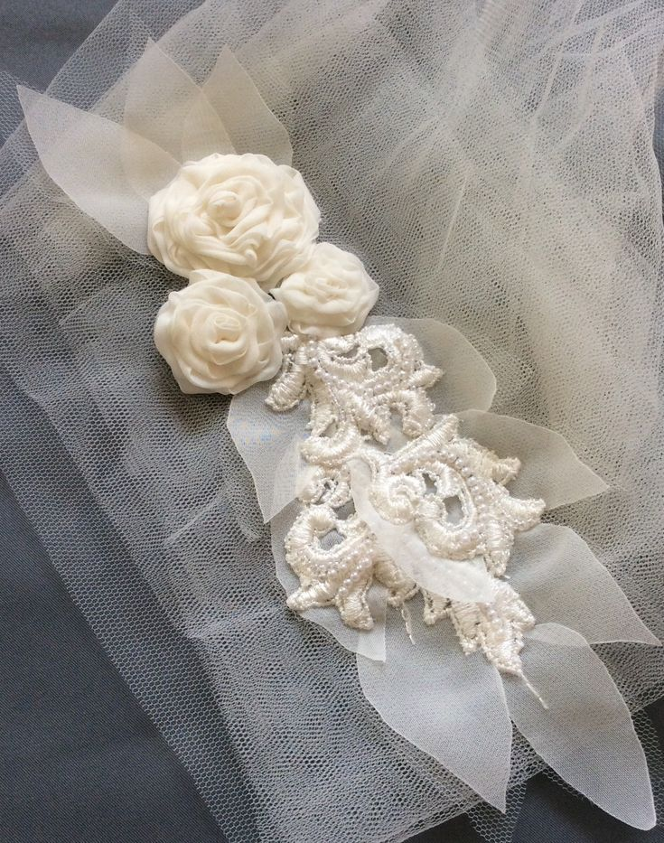A gorgeous bridal sash of fabric roses, leaves and lace set onto a tulle base - makes a beautiful sheer bow at the back when tied...  #weddingsash #bridalsash #bridalaccessories