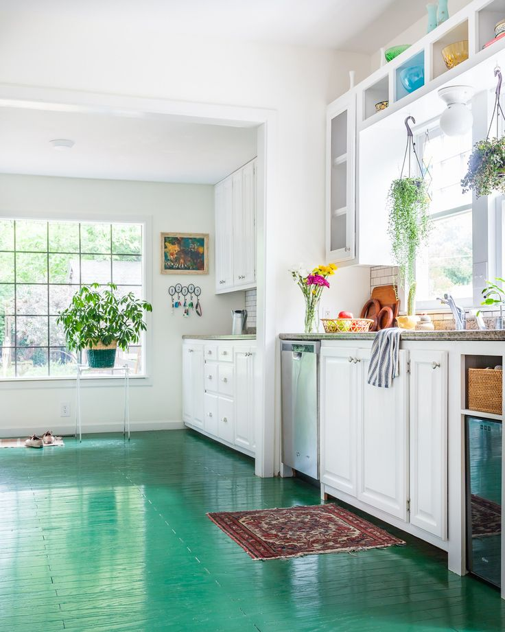 love this kitchen with its green painted floors so much