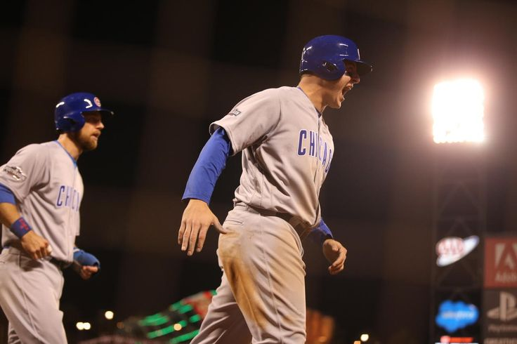 Cubs first baseman Anthony Rizzo scores in the ninth inning.