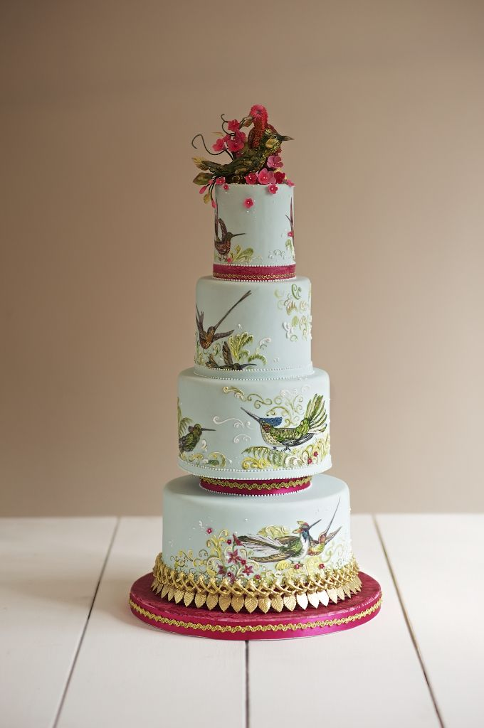 Hand painted tropical birds with gold highlights and sugar cherry blossom with handmade sugar birds sat proudly on top. This opulent bespoke cake is truly unique.