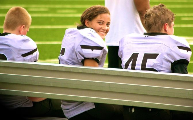 A picture is worth a thousand words! Karlie playing Quarterback in her first game of tackle.
