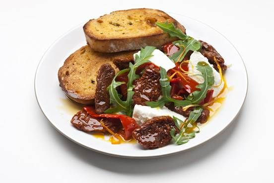 Crunchy bread, sweet and savoury slow roast tomatoes, creamy ricotta, spicy rocket and fresh citrus zest all add up to a glorious riot of colour and flavour. This is a perfect meal to prepare when you want to eat well but don't have time to cook.