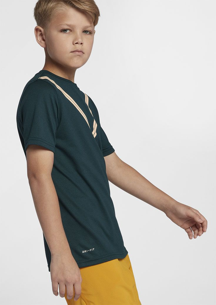be65e8fb892 This sharp looking Nike tennis shirt offers a cool look for the courts with  a comfortable
