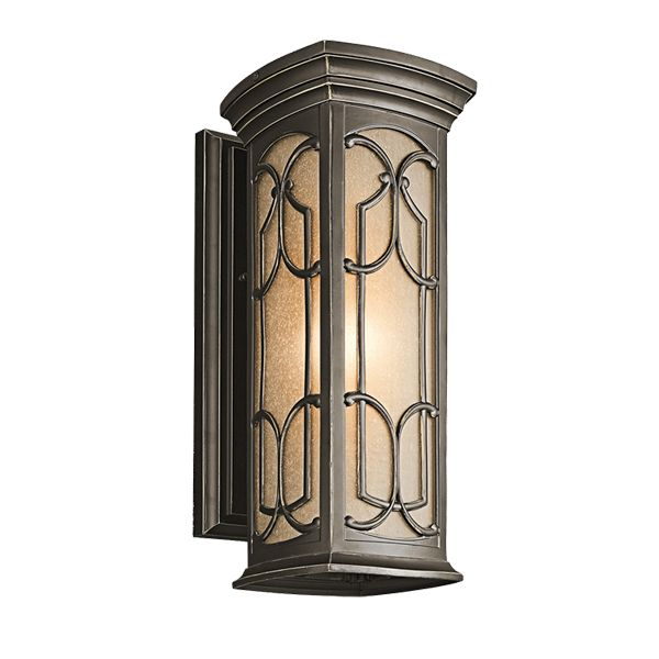 THE INTRICATE DETAILS OF THE OLDE BRONZE PANELS ON THIS WALL LANTERN CREATE DELIGHTFUL SHADOW PATTERNS ON ADJOINING WALL SURFACES AND WALKWAYS.