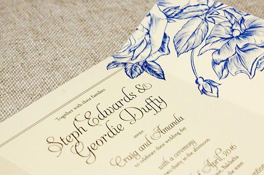 cream wedding invitation - folds closed - blue roses