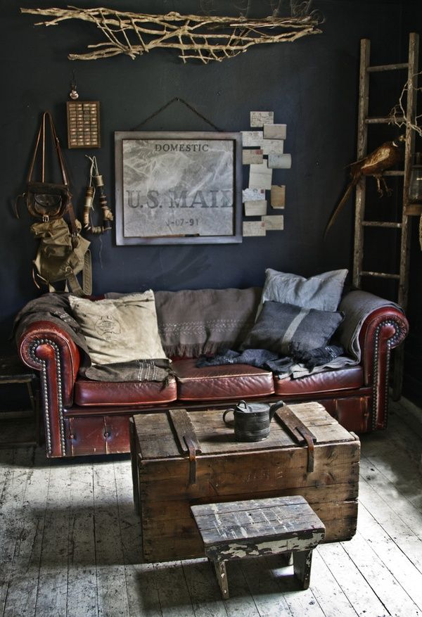 dark navy walls, rustic accessories, weathered leather couch