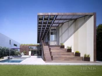 Contemporary house with cement panel facade, cantilevered roof and celerestory windows