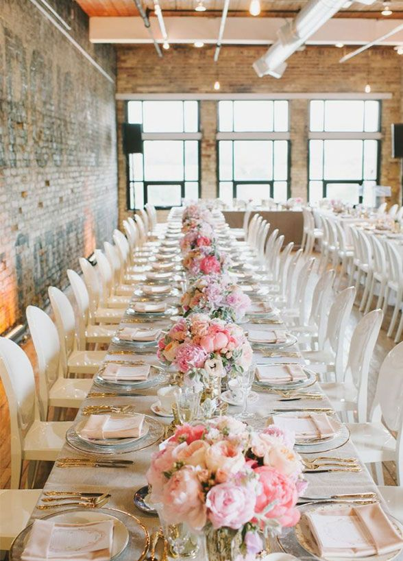 One big wedding trend we're seeing this year is banquet-style seating. Instead of small tables clustered together, brides are opting for one to three longer tables that can fit all of their guests. Banquet tables encourage everyone to mingle with one another and since guests will spend the majority