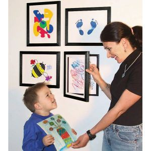 Hang on wall, open glass cover, insert child's masterpiece, close door. Repeat every time your little love brings home artistic stuff.