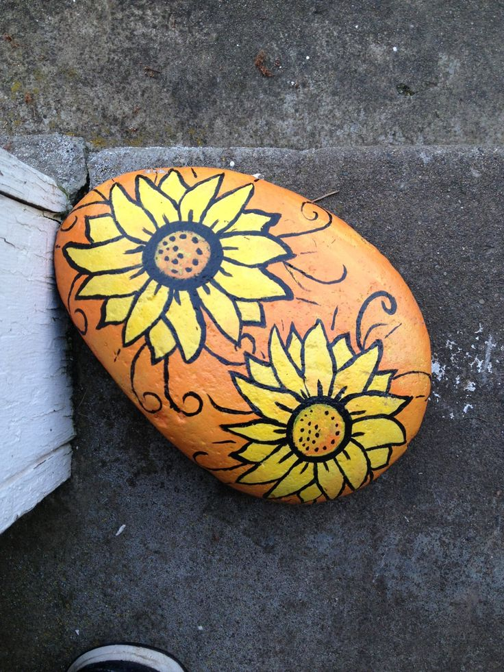 My Sunflower rock I painted.