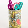 Cute Tool Storage  Scissors, pens, and paintbrushes can easily get lost in the shuffle when hidden in a drawer. Store similar tools together in clean, paper-wrapped cans.