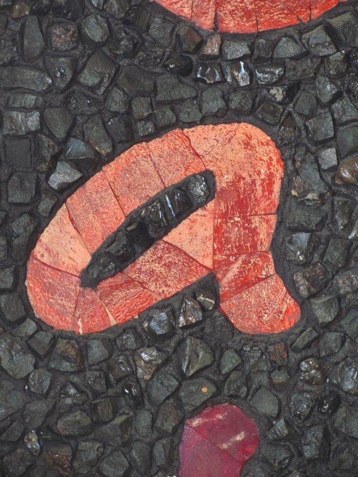 """a""  orange-red in black"
