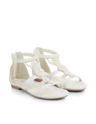 Perfect for special occasions in the sunshine, our pretty ivory sandal for girls are decorated with the glossiest pearl beads. Zip fastenings on the heels cr...
