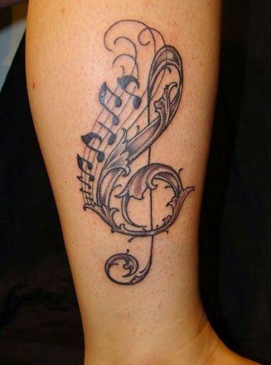 Tatouage femme mollet clé de sol et note d emusique https://tattoo.egrafla.fr/2016/02/08/modele-tatouage-note-musique/