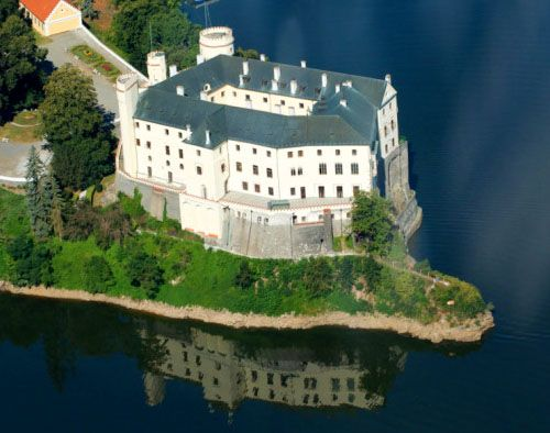 """Orlík Castle, Orlík nad Vltavou, Písek, South Bohemia, Czech Republic. www.castlesandmanorhouses.com The name Orlík comes from the word """"young eagle"""" (Czech: Orel). The castle would have resembled an eagle or nest perched upon the rocky outcrop high..."""