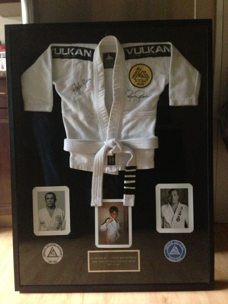 Gi autographed by Royler and Royce Gracie and framed in a shadow box