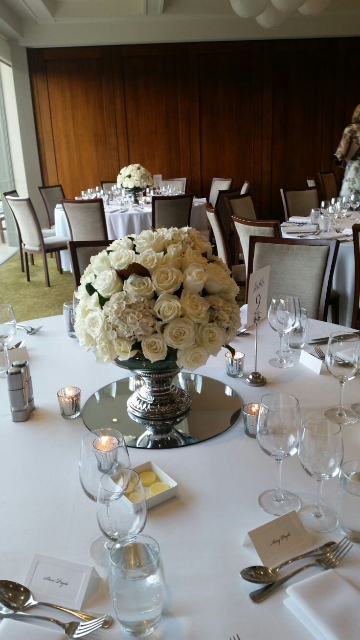 A footed bowl arrangement with white roses n hydrangeas