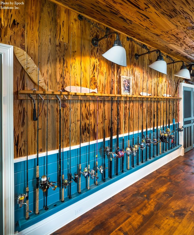Personalizing your man cave is all about displaying your interest. A well-decorated wall with a fisherman's most cherished collection, his best fishing rods.