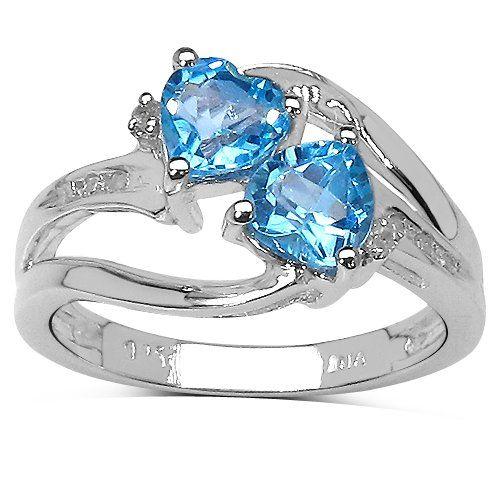Une collection bague du Diamant : bague de 2 la Topaze Bleue se range d'un coeur avec le Diamant croisé mis sur les Épaules en Argent. Taille de la bague 49