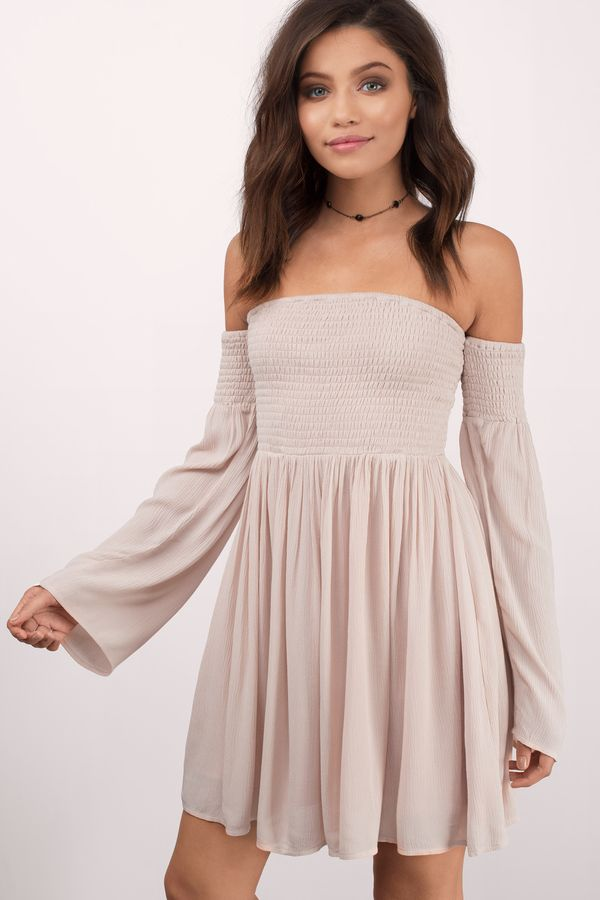 Designed by Tobi. The Ellie Off The Shoulder Dress features a smocked upper body and skater skirt bottom. Bell shaped sleeves for a flirty look. Pair