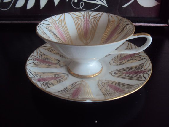 This lovely teacup and saucer set were made by Schumann Porcelain of Arzburg, Germany. Its lovely pink and gold pattern has a real midcentury modern feel to it. Likely manufactured in the late 1950s.   There is one small, nearly unnoticeable chip in the saucer seen in the second photo. Other than that, perfect!  https://www.etsy.com/listing/224709742/beautiful-mid-century-modern-teacup