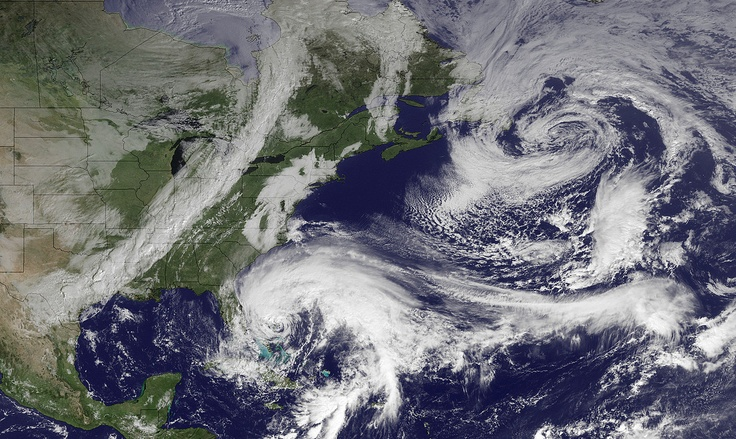 In this image taken by NOAA's GOES East at 2:45 GMT on Friday, Oct. 26, 2012, Hurricane Sandy is seen in the center bottom.