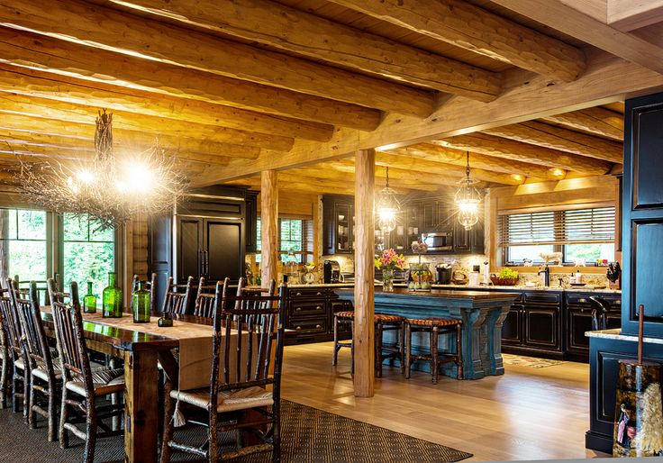 Open floorplan kitchen so no one ever has to feel left out! Designed by Beaver Mountain Log & Cedar Homes.