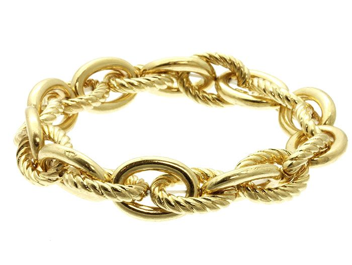 MADELYN TEXTURED GOLD CHAIN LINK BRACELET  A collector's must-have. The Madelyn bracelet is designed for simplicity of wear, showcasing an oval cable chain with smooth and textured links on stretch. A staple for minimalism or for layering.