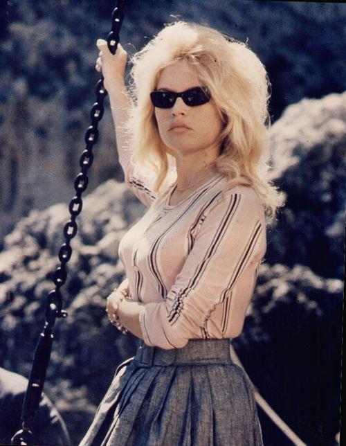 Brigitte Bardot on the set of Jean-Luc Godard's Le Mépris (1963). #girlskickass