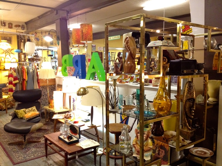 """SPARKLEBARN acquired this big hunkin' circa 1986 gold display case with smoked glass shelving earlier in the week down at Fremont Vintage Malll.    We think it has potential for a real """"touch of class"""" when showing off our smaller recycled antiques, glassware, and bear skulls."""