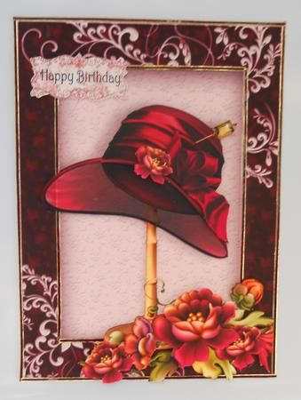 Beautiful Vintage Flowers with Deep Red Floppy Hat on Craftsuprint created by Linda Short - Printed on matt photo paper and attached to shimmer card. Trimmed and built upimage with foam pads, Finished by adding trim toedge of card and frame. Alovely card in rich jewel shades.