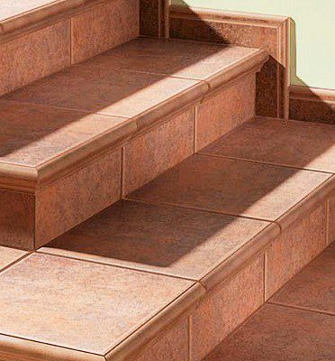Escalera cer mica realizada con pelda os con torelo pegado for Ceramica para exteriores