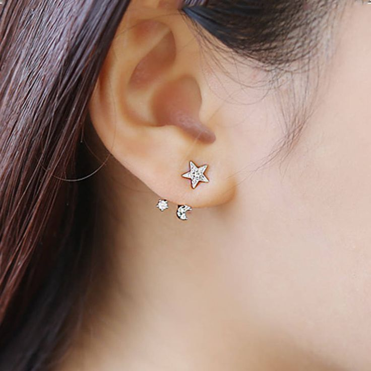 Stunning Celestial two-way earrings with dainty decoration.Available as Rhodium (White gold colour) plated, Rose Gold plated, and Gold plated. All of our jewellery is delivered in a complimentary gift box (see images)Beautiful earrings for any age. Lovers of celestial decorations will adore these. Star-shaped studs decorated with a metal texture and 6 stones can be worn alone for an easy or simple look. The double drop bar houses a delicate little moon, again decorated with stones really…